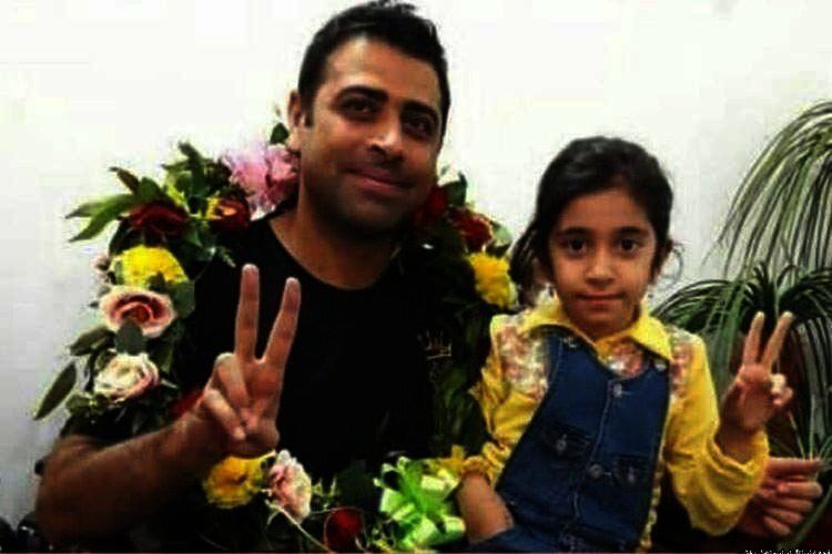 Iran labor activist Esmail Bakhshi with daughter after release from prison